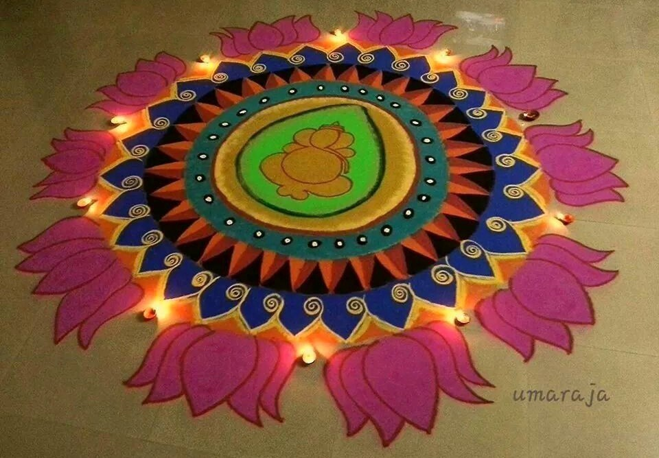 Ganesh Ji Rangoli with Diyas & Colors