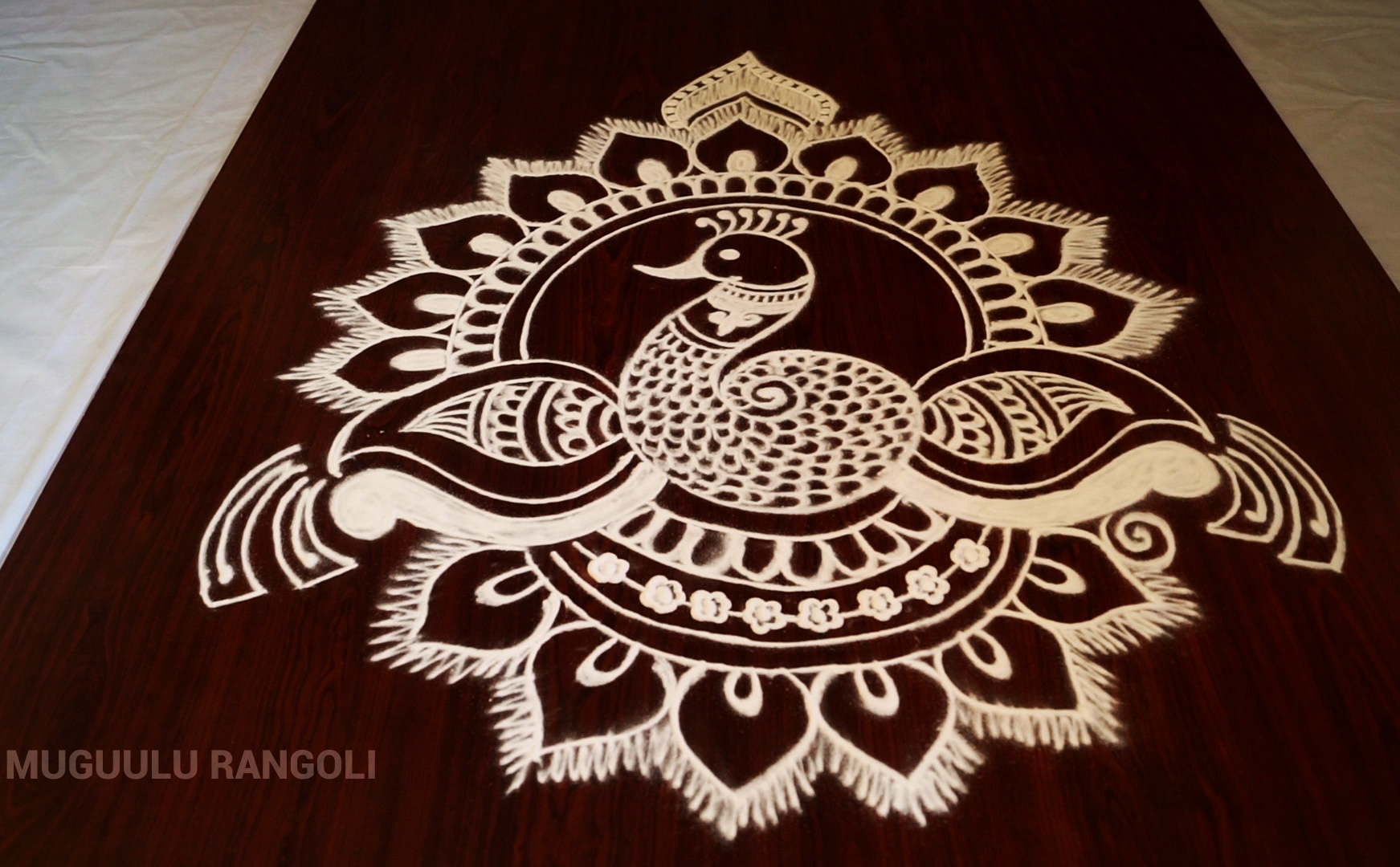 White Powder Peacock Rangoli Design